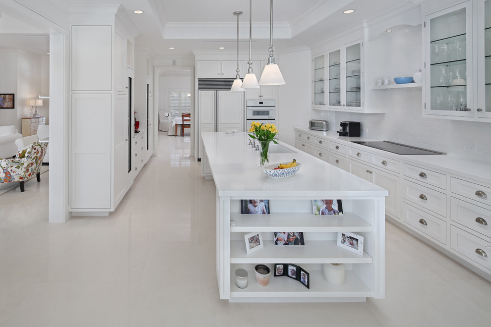 Inspiration for a transitional kitchen remodel in Miami with glass-front cabinets, white cabinets and paneled appliances
