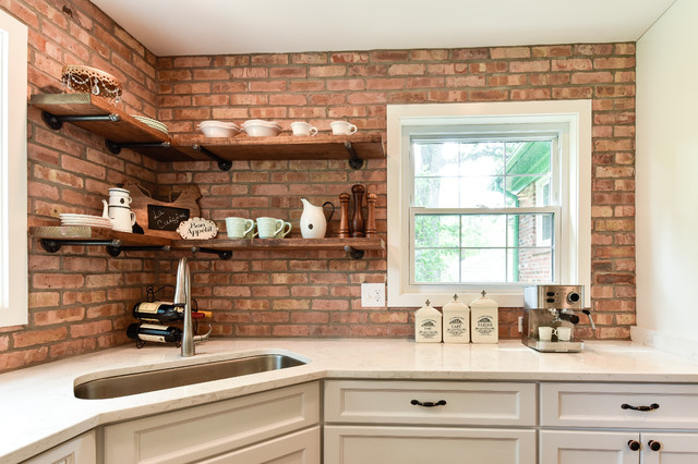 Mid-sized country u-shaped dark wood floor and brown floor enclosed kitchen photo in DC Metro with an undermount sink, white cabinets, stainless steel appliances, shaker cabinets, wood countertops, red backsplash, brick backsplash and a peninsula