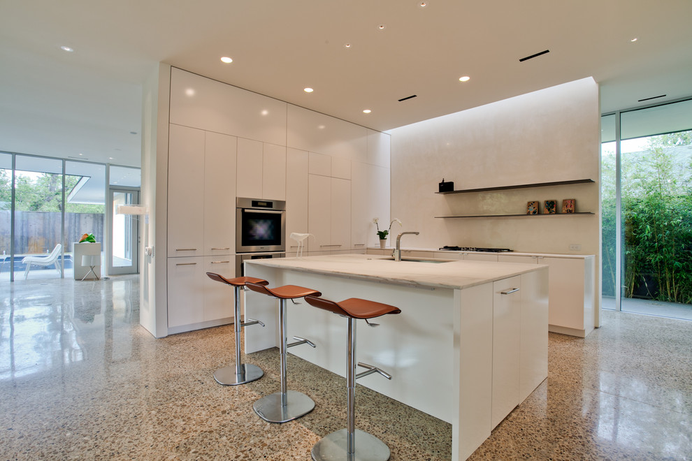 Inspiration for a modern kitchen remodel in Dallas with marble countertops