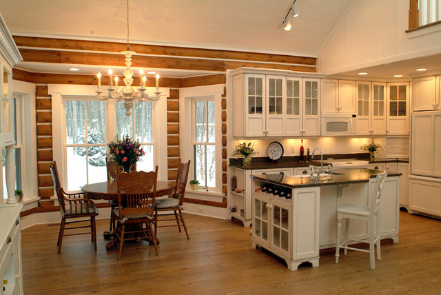 Example of a mountain style l-shaped eat-in kitchen design in Grand Rapids with glass-front cabinets, white cabinets, white backsplash and paneled appliances