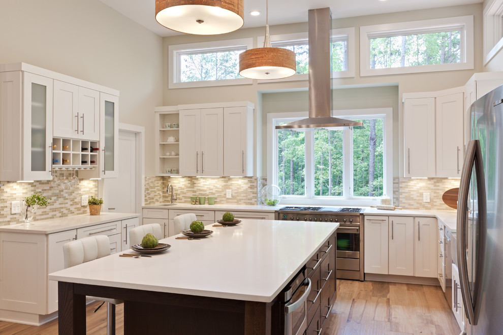 Example of a huge trendy u-shaped porcelain tile and beige floor eat-in kitchen design in Atlanta with a farmhouse sink, shaker cabinets, white cabinets, quartz countertops, beige backsplash, glass tile backsplash, stainless steel appliances, an island and white countertops