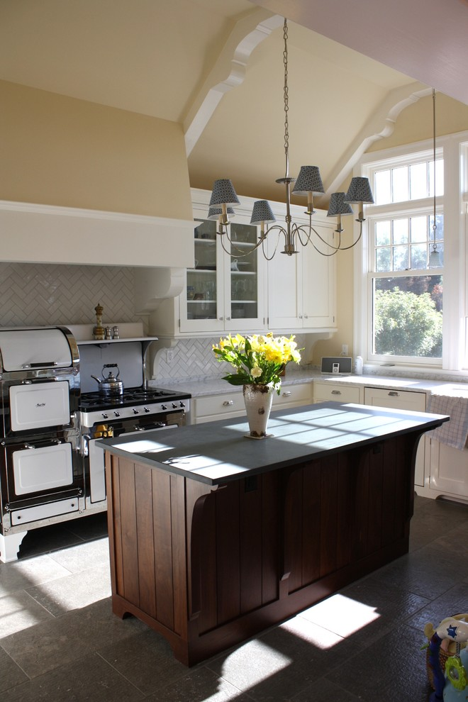 Kitchen - industrial kitchen idea in San Francisco with shaker cabinets