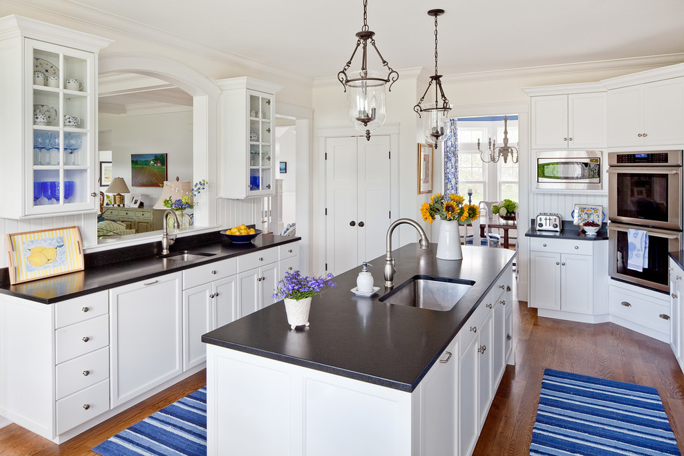 Enclosed kitchen - traditional enclosed kitchen idea in Portland Maine with an undermount sink, shaker cabinets, white cabinets and paneled appliances