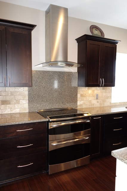 Mid-sized transitional u-shaped dark wood floor eat-in kitchen photo in Other with an undermount sink, recessed-panel cabinets, dark wood cabinets, quartzite countertops, beige backsplash, stone tile backsplash, stainless steel appliances and an island