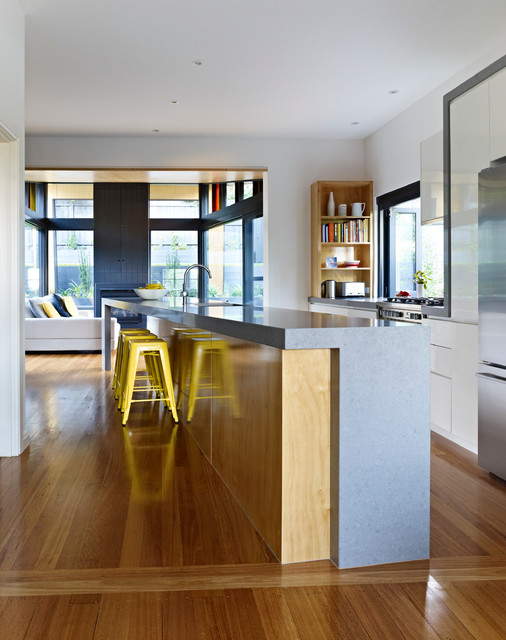 Inspiration for a large contemporary galley eat-in kitchen in Melbourne with an undermount sink, flat-panel cabinets, white cabinets, quartz benchtops, stainless steel appliances, medium hardwood floors and an island.
