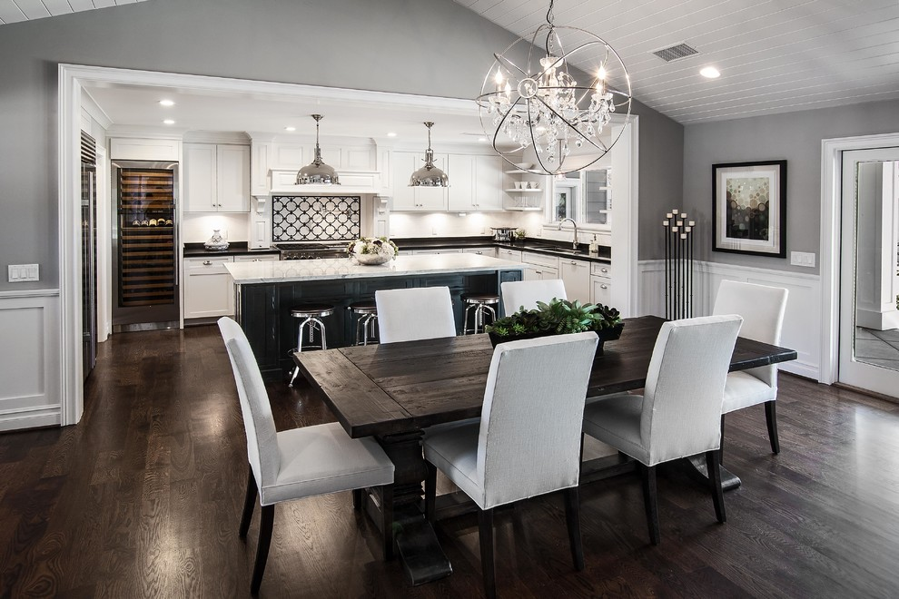 Mid-sized transitional u-shaped medium tone wood floor open concept kitchen photo in Los Angeles with an undermount sink, shaker cabinets, white cabinets, marble countertops, white backsplash, ceramic backsplash, stainless steel appliances and an island