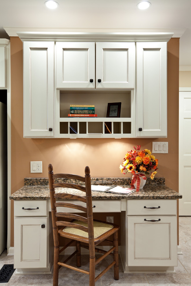 Example of a mid-sized classic single-wall porcelain tile and beige floor eat-in kitchen design in Atlanta with recessed-panel cabinets, white cabinets, granite countertops and brown countertops