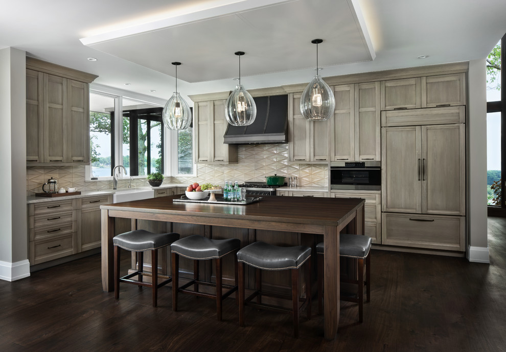 Kitchen - transitional l-shaped dark wood floor and brown floor kitchen idea in Detroit with a farmhouse sink, recessed-panel cabinets, medium tone wood cabinets, wood countertops, beige backsplash, paneled appliances, an island and brown countertops