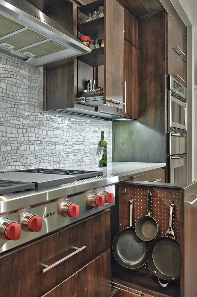Kitchen - mid-sized contemporary single-wall medium tone wood floor kitchen idea in Austin with flat-panel cabinets, mosaic tile backsplash, stainless steel appliances, quartz countertops, gray backsplash and dark wood cabinets