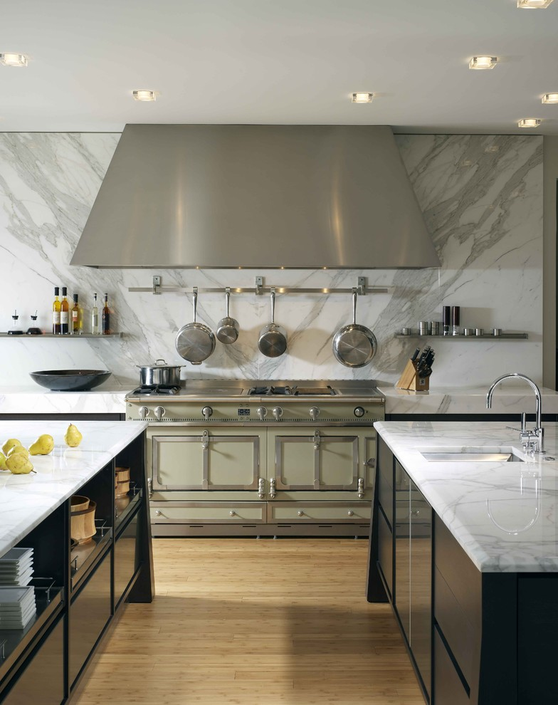 Kitchen - contemporary kitchen idea in Houston with colored appliances, black cabinets, white backsplash and marble backsplash