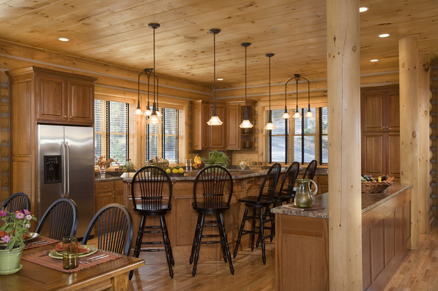 Kitchen And Dining In A Rustic Round Log Home