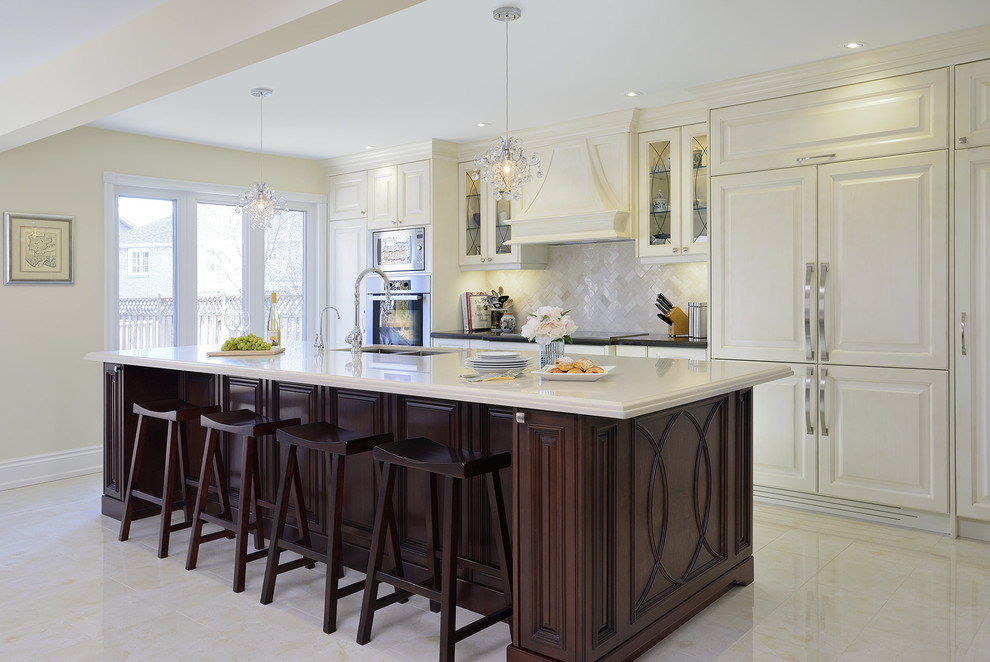 Inspiration for a mid-sized timeless galley porcelain tile kitchen remodel in Toronto with an undermount sink, raised-panel cabinets, quartz countertops, beige backsplash, paneled appliances, an island and white cabinets