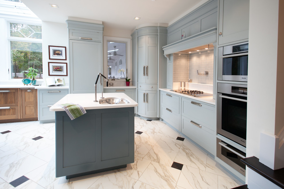 Inspiration for a mid-sized contemporary l-shaped marble floor and white floor eat-in kitchen remodel in DC Metro with recessed-panel cabinets, blue cabinets, an undermount sink, gray backsplash, glass tile backsplash, stainless steel appliances, an island, quartz countertops and turquoise countertops