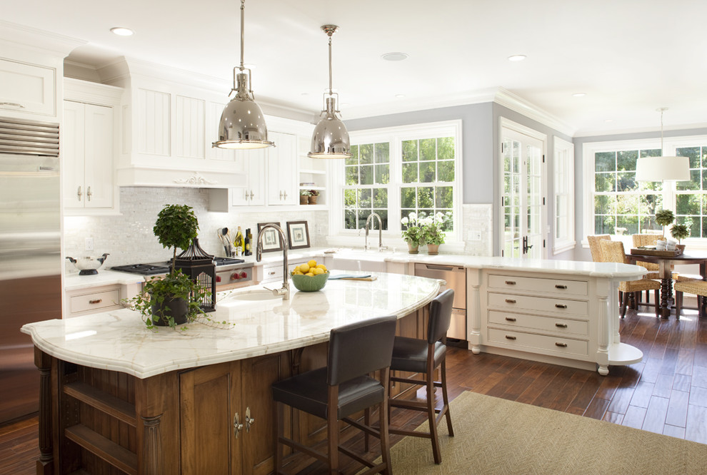 Large elegant l-shaped medium tone wood floor eat-in kitchen photo in San Francisco with stainless steel appliances, a farmhouse sink, beaded inset cabinets, white cabinets, marble countertops, white backsplash, mosaic tile backsplash and an island
