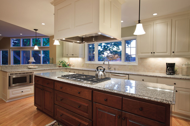 Example Of A Classic Kitchen Design In Milwaukee With Raised Panel  Cabinets, Beige Cabinets