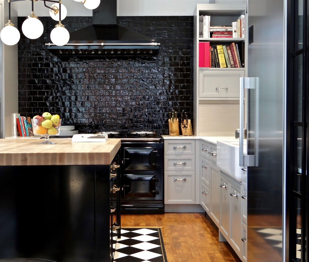 Example of a small transitional l-shaped medium tone wood floor kitchen design in Calgary with a farmhouse sink, marble countertops, black backsplash, ceramic backsplash, stainless steel appliances, an island, recessed-panel cabinets and white cabinets