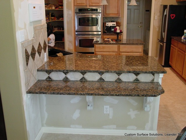 Kitchen backsplash extension add on granite counters for Traditional kitchen extensions