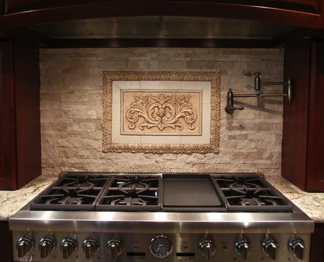 kitchen backsplash using floral tile and acanthus liners