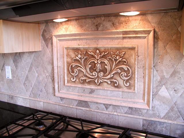 kitchen backsplash using floral tile and stone liners