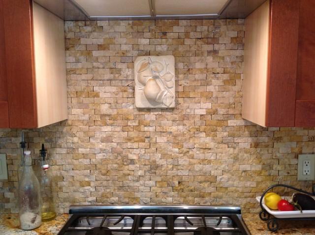 Kitchen backsplash with split face stone