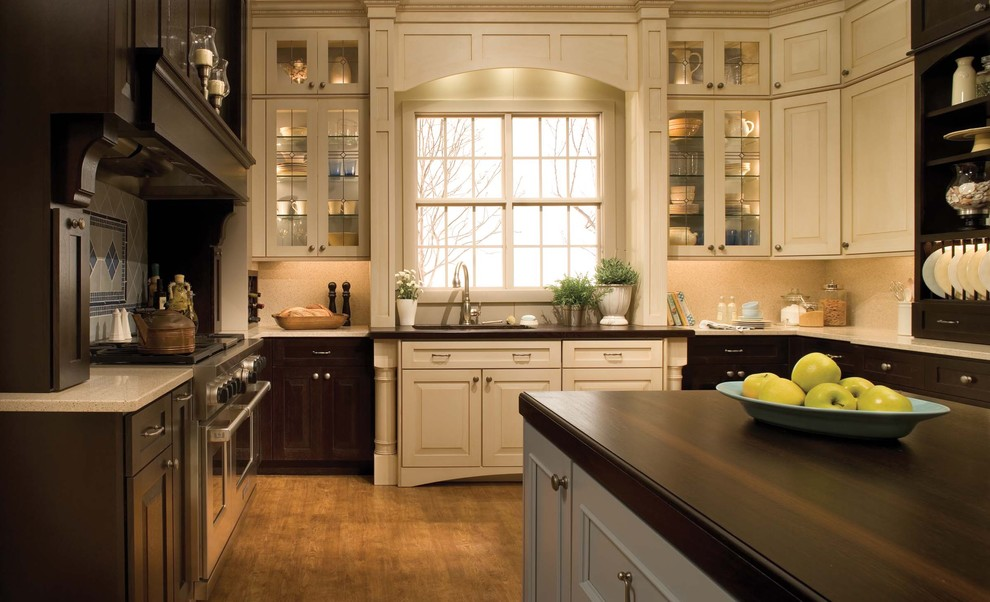 Example of a classic kitchen design in Orange County with glass-front cabinets