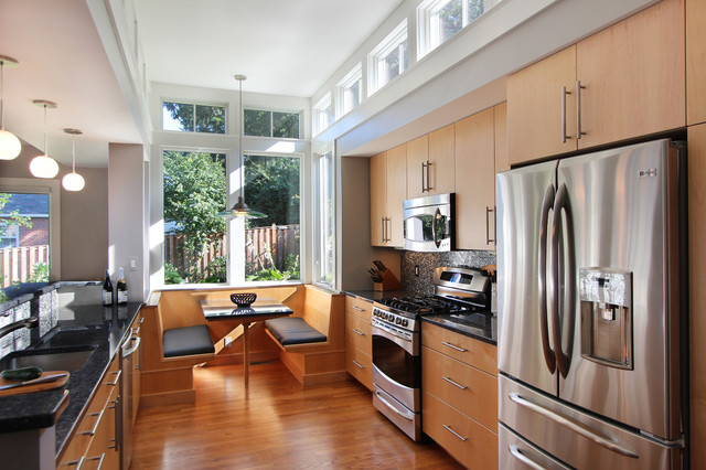 Eat-in kitchen - contemporary galley eat-in kitchen idea in DC Metro with stainless steel appliances, a single-bowl sink, flat-panel cabinets and light wood cabinets