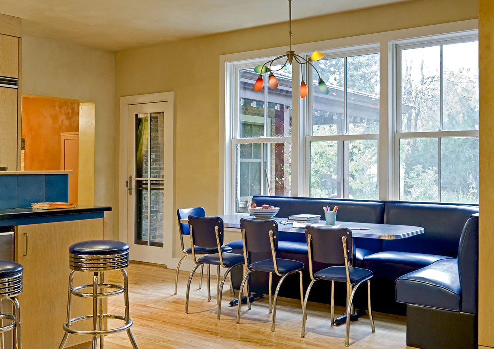 Trendy eat-in kitchen photo in Burlington with flat-panel cabinets and light wood cabinets
