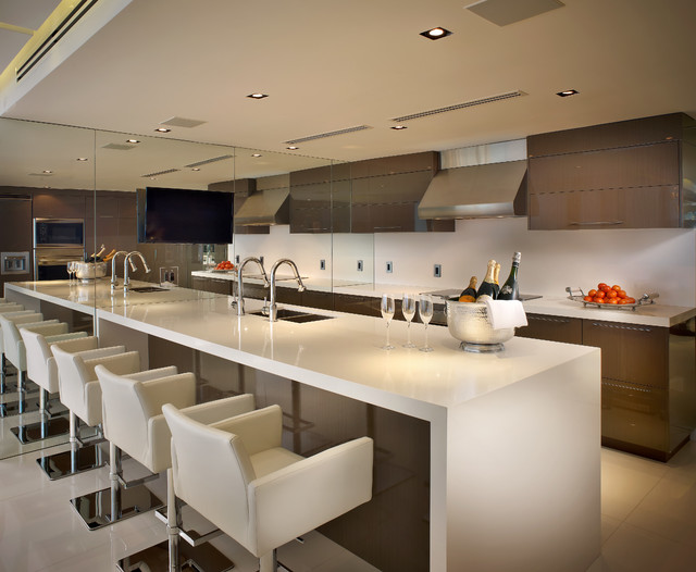 Kitchen - contemporary galley kitchen idea in Miami with a double-bowl sink, flat-panel cabinets, brown cabinets and an island