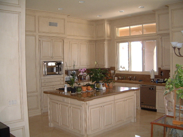 Kitchen cabinets with cream and coffee glazed finish for Cream kitchen cabinets