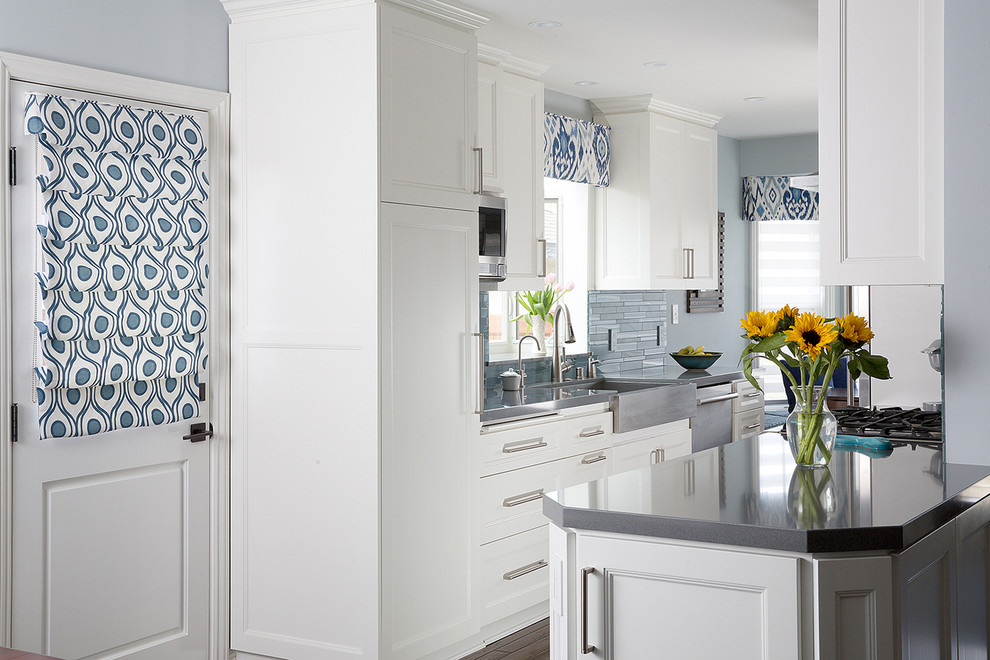 Example of a mid-sized classic galley dark wood floor open concept kitchen design in Los Angeles with a farmhouse sink, shaker cabinets, white cabinets, quartz countertops, blue backsplash, glass tile backsplash, stainless steel appliances and no island