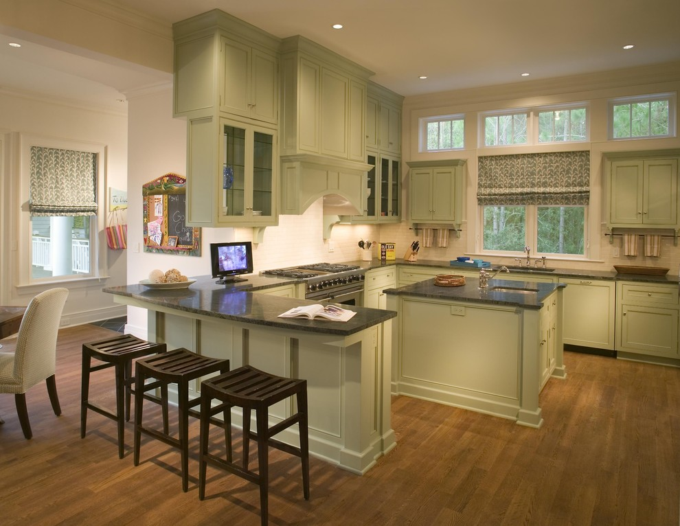Example of a classic eat-in kitchen design in Charleston with stainless steel appliances, recessed-panel cabinets and green cabinets