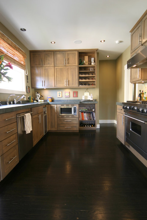 light oak cabinets with dark wood floors brown hardwood floors 376