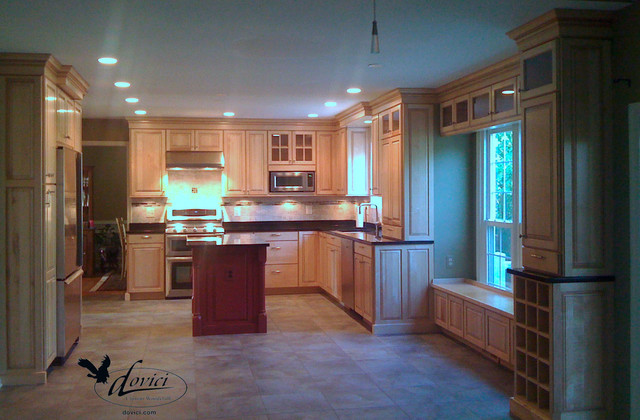 kitchen contrasting sand colored cabinets and black countertops