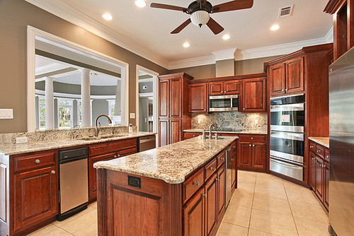 Grant Beige Wall Color And Honey Cypress Cabinets With