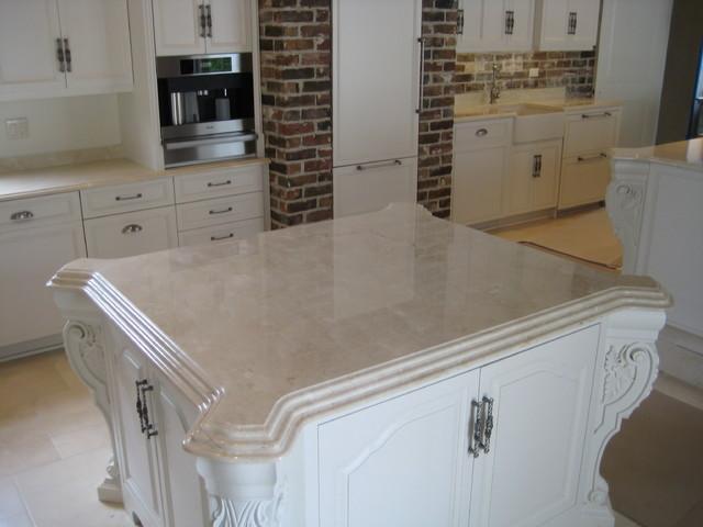 Delightful Kitchen: Crema Marfil Marble Traditional Kitchen