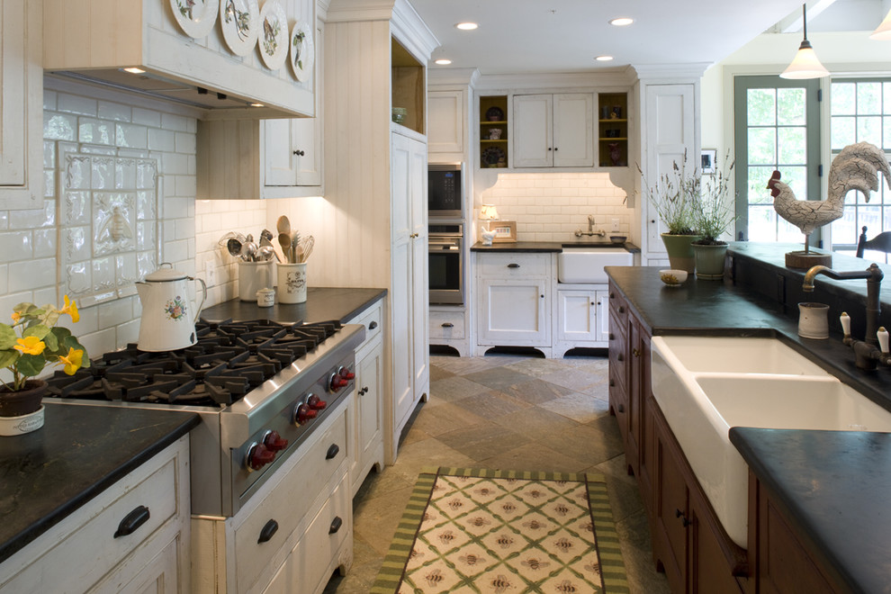 Example of a classic kitchen design in Philadelphia with beaded inset cabinets, subway tile backsplash, a double-bowl sink, soapstone countertops, white cabinets and white backsplash