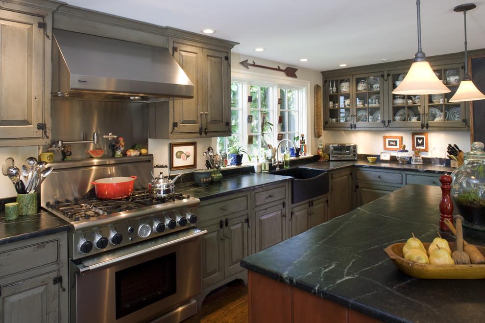 Kitchen - traditional kitchen idea in Philadelphia with distressed cabinets, stainless steel appliances and beaded inset cabinets