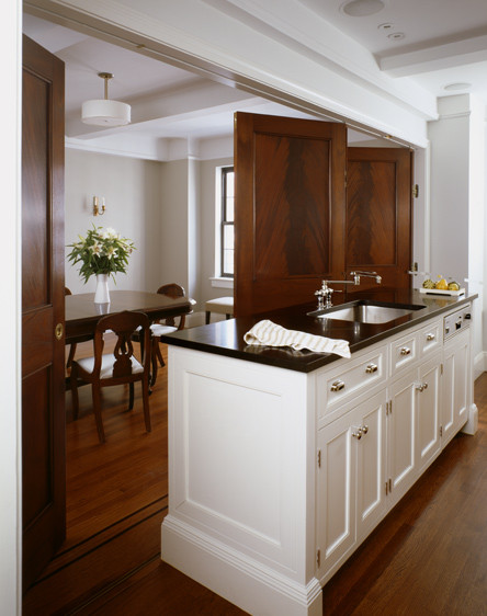 Ceiling Beam As Divider Between Dining And Kitchen