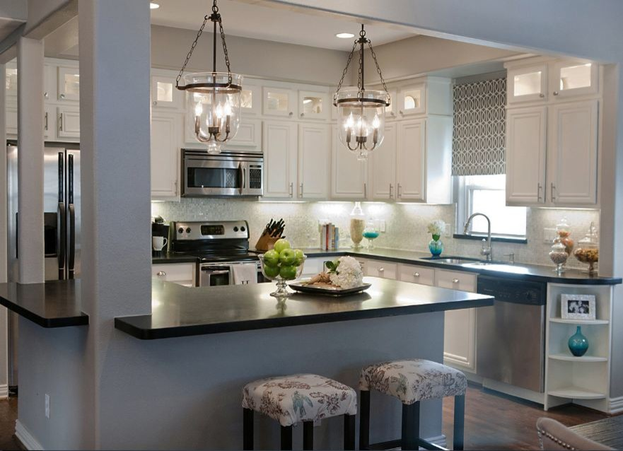 Eat-in kitchen - traditional l-shaped eat-in kitchen idea in Nashville with an undermount sink, flat-panel cabinets, white cabinets, granite countertops, blue backsplash and stainless steel appliances