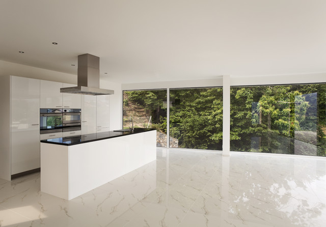 Kitchen design with calacatta gold marble floor tiles for Modern kitchen tile flooring