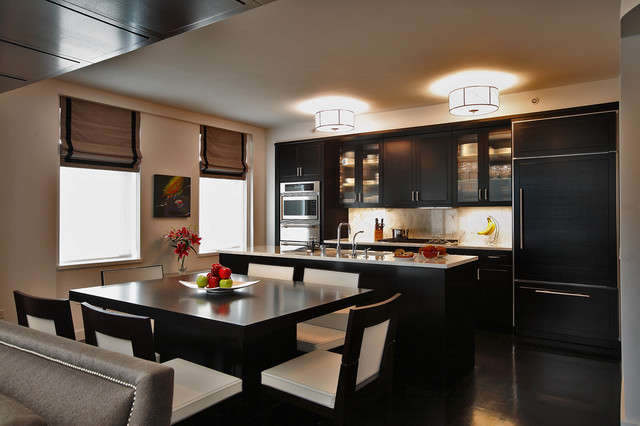 Example Of A Trendy Galley Kitchen Design In New York With Glass Front Cabinets