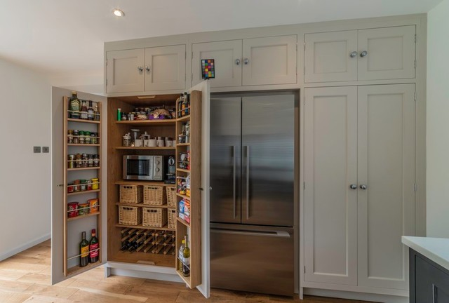 Photo of a contemporary kitchen/diner in Cheshire with light hardwood flooring.