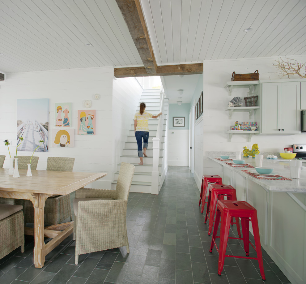 Eat-in kitchen - large coastal gray floor and slate floor eat-in kitchen idea in Atlanta with shaker cabinets, gray cabinets, marble countertops and an island