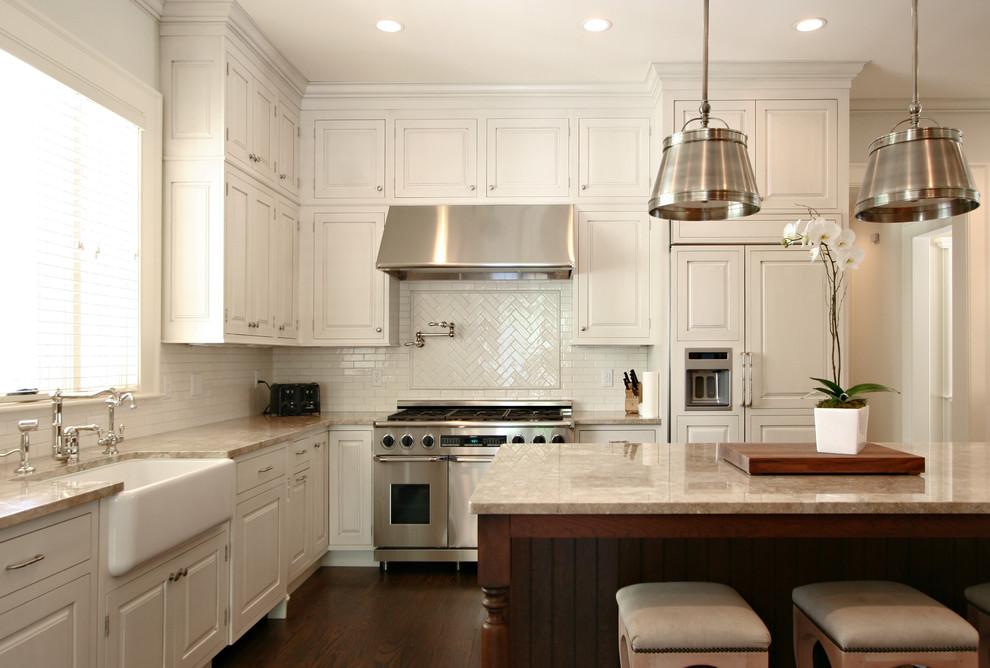 Elegant l-shaped kitchen photo in Atlanta with a farmhouse sink, paneled appliances, raised-panel cabinets, white cabinets, marble countertops, white backsplash and subway tile backsplash