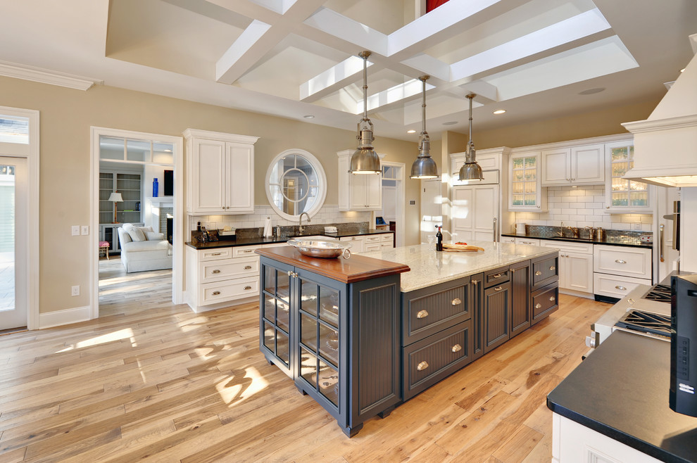 Inspiration for a coastal kitchen remodel in Philadelphia with recessed-panel cabinets and subway tile backsplash