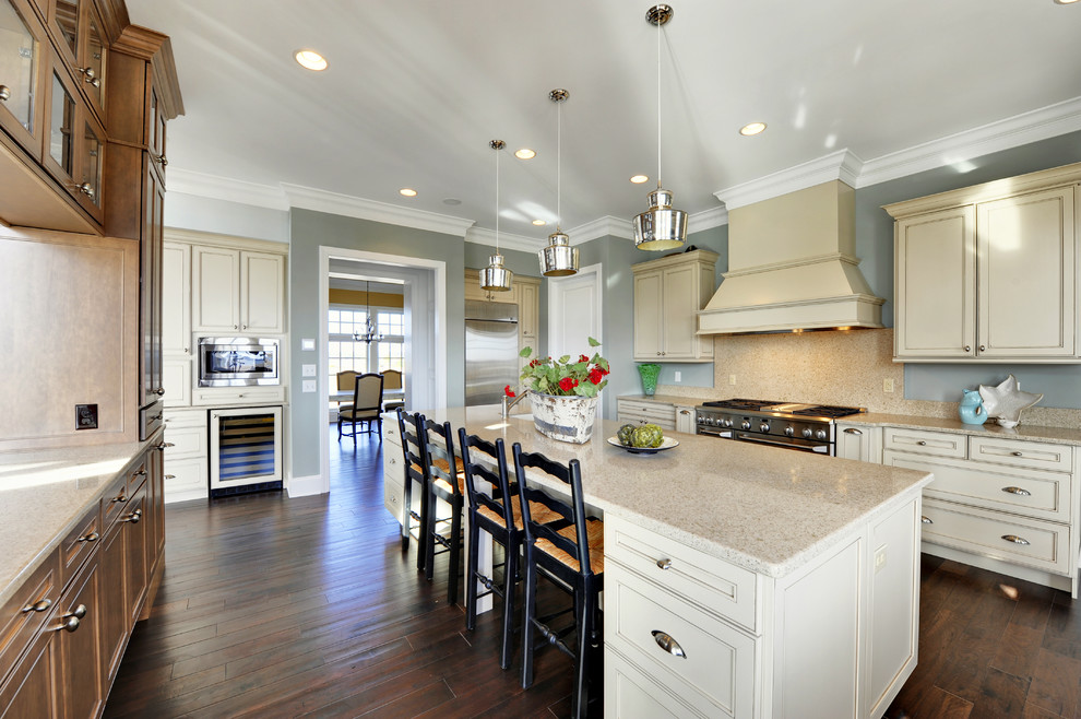 Inspiration for a contemporary enclosed kitchen remodel in Philadelphia with beaded inset cabinets, beige cabinets, beige backsplash and stainless steel appliances