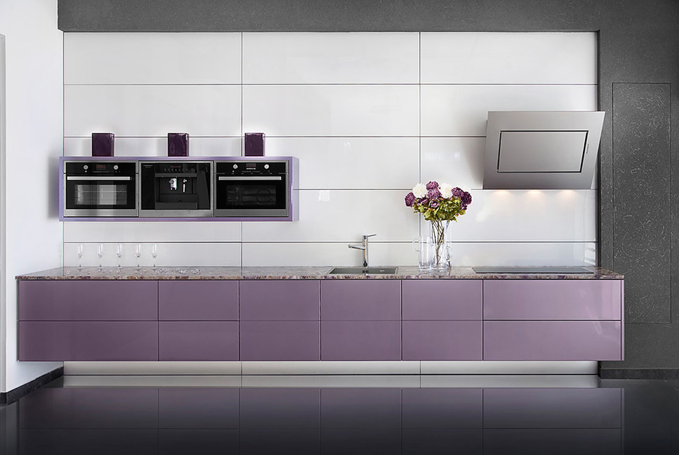 Example of a minimalist kitchen design in Other with flat-panel cabinets and white backsplash