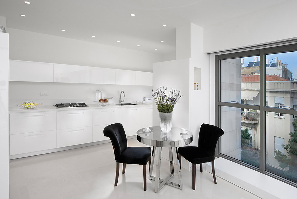 Example of a minimalist kitchen design in Other with flat-panel cabinets and white cabinets