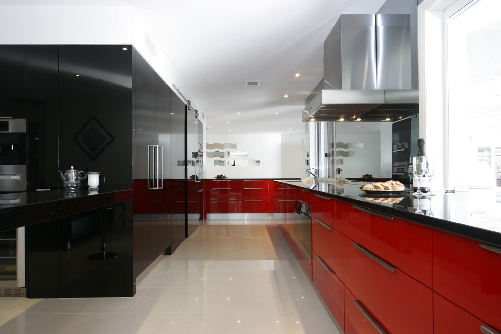 Inspiration for a modern galley kitchen remodel in Brisbane with flat-panel cabinets and red cabinets