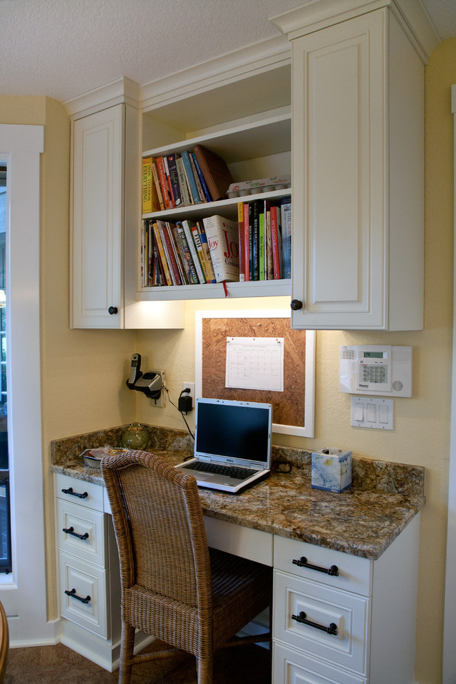 Large elegant l-shaped concrete floor eat-in kitchen photo in Seattle with a farmhouse sink, raised-panel cabinets, white cabinets, granite countertops, multicolored backsplash, mosaic tile backsplash, paneled appliances, an island and multicolored countertops
